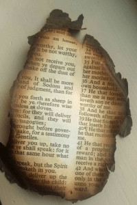 bible page from fire
